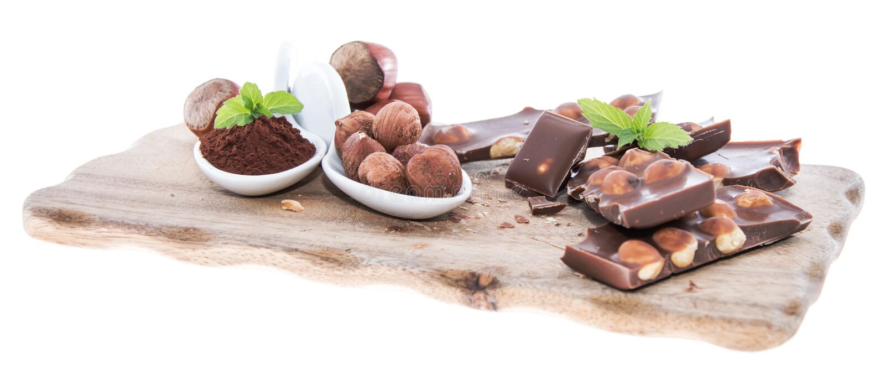 Hazelnut Chocolate isolated on white. Pieces of dark Hazelnut Chocolate isolated on white background royalty free stock photo