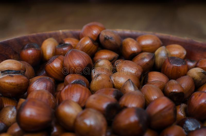 Hazelnuts scattered on boards, photographed from above, forming a uniform background stock photo