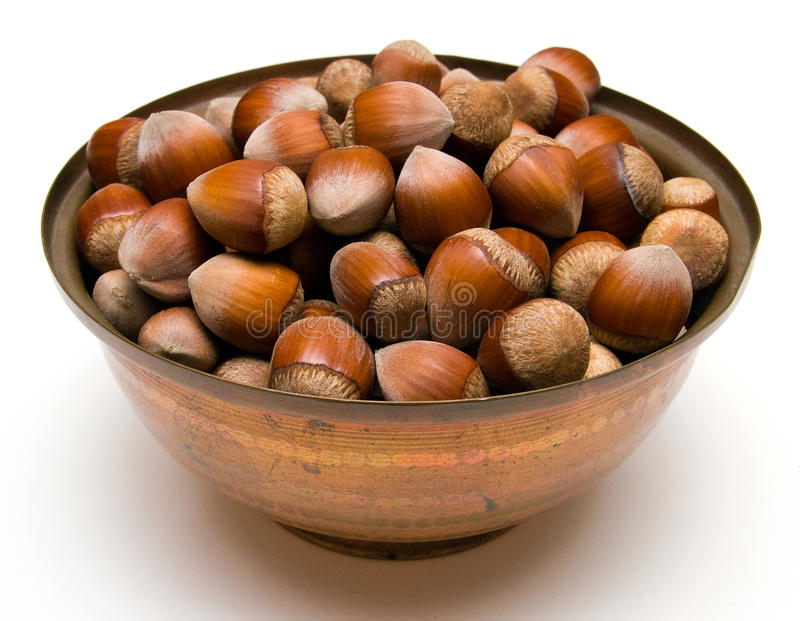 Download Hazelnuts in a copper bowl stock image. Image of nature - 15911441