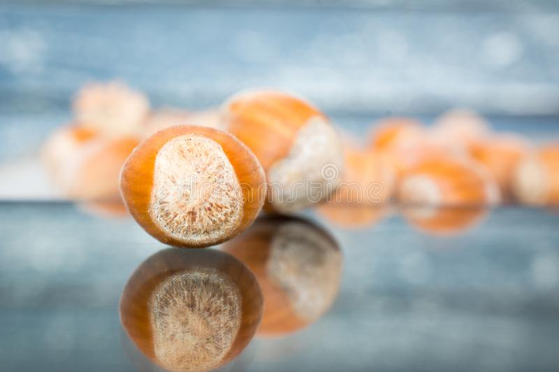 Hazelnuts in shells on the glass table royalty free stock photo