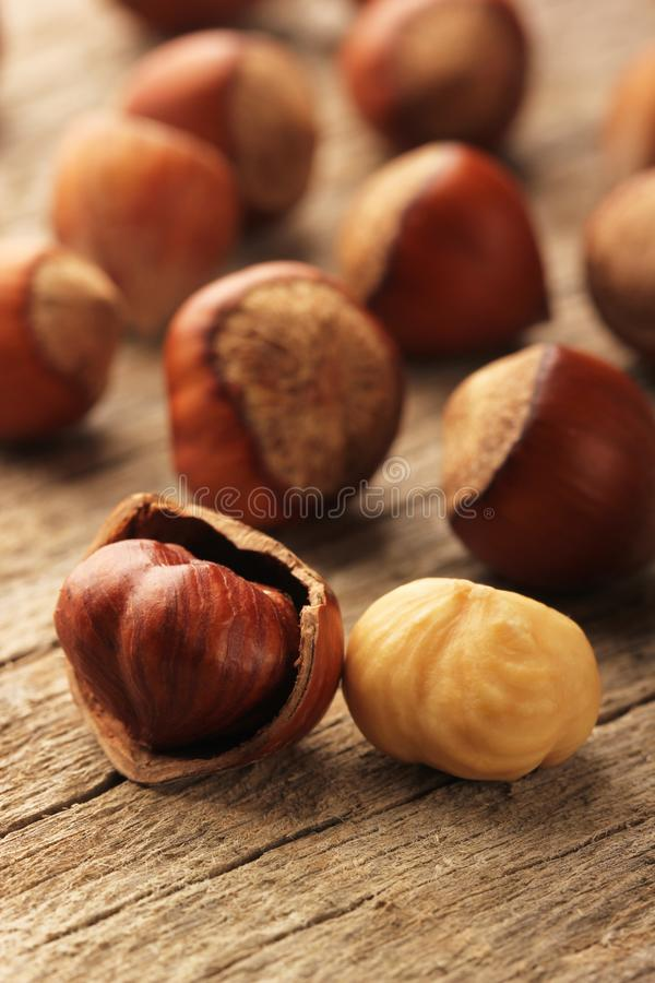 Hazelnuts on wooden table royalty free stock photo