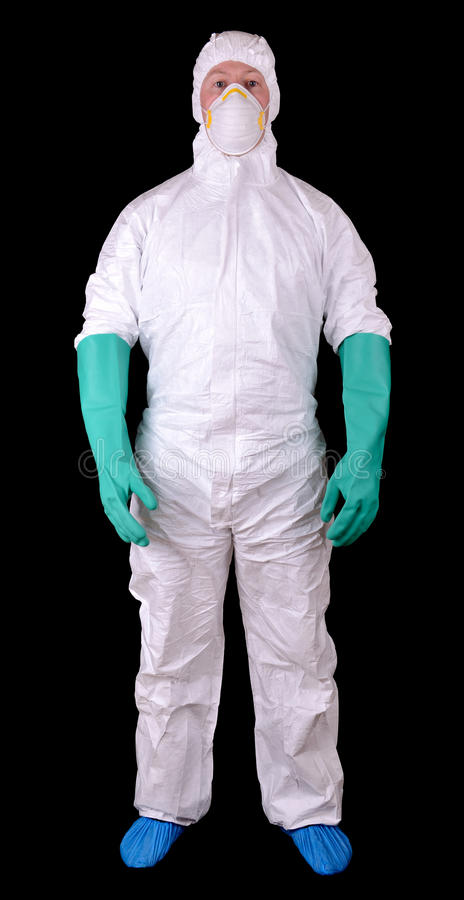 Hazmat suit. Man in full protective hazmat suit isolated on a black background stock photos