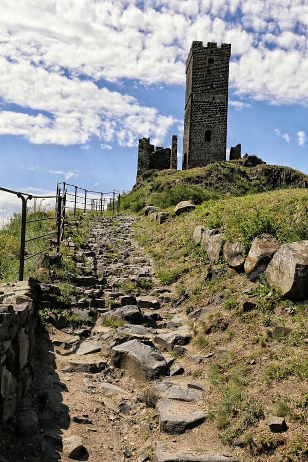 Hazmburk castle white tower with stony road to hill stock photo