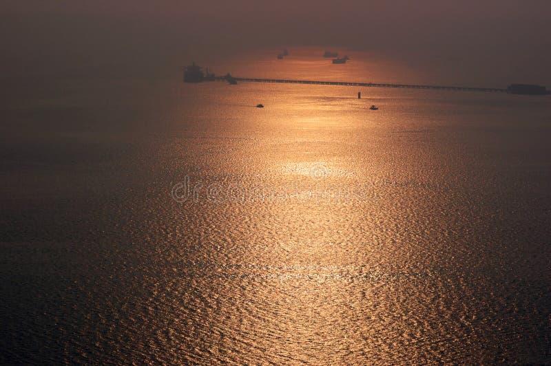 Hazy golden sunset on Arabian sea stock image