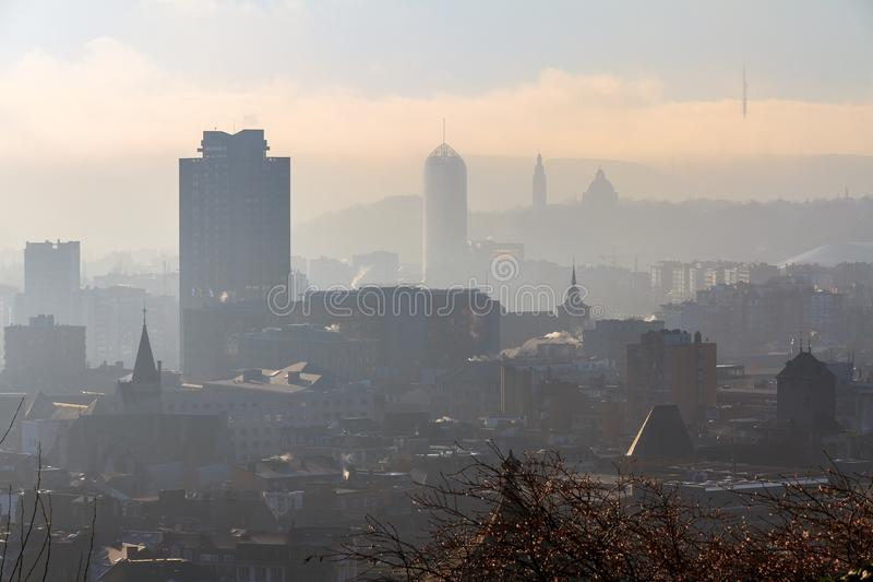 Hazy Liege with sunshine. Beautiful cityscape view of the skyline of Liege, Belgium, with skyscrapers on a sunny and hazy winter day seen from the top of the stock photos