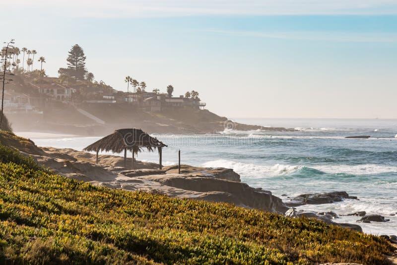 Hazy Morning on Windansea Beach in La Jolla. California with iconic surfer shack stock photos