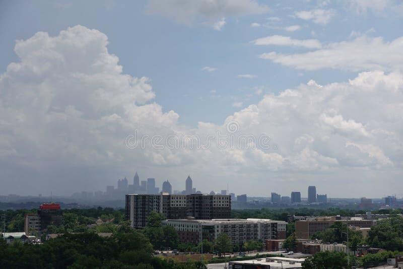 Hazy skyline view of Atlanta, Georgia. A hazy skyline view of Atlanta, Georgia on a bright sunny day with big puffy clouds stock images