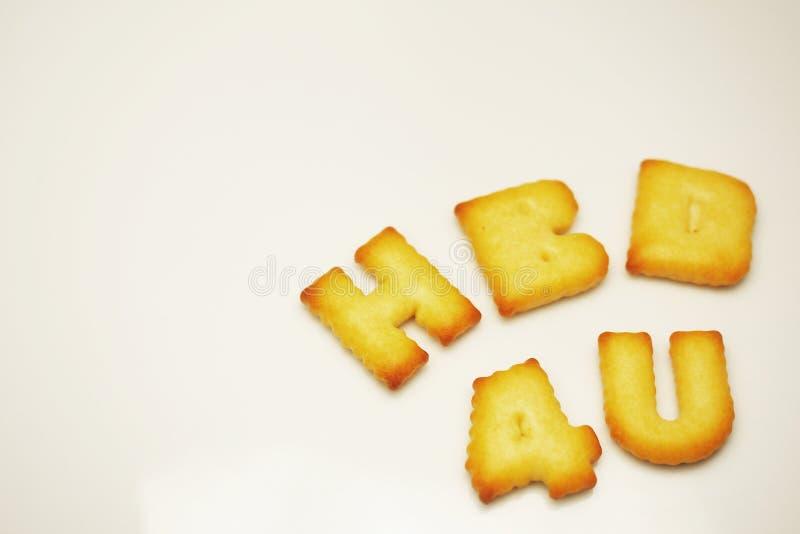 HBD 4U χρόνια πολλά για σας λέξη από τα μπισκότα αλφάβητου στο άσπρο υπόβαθρο στοκ φωτογραφίες