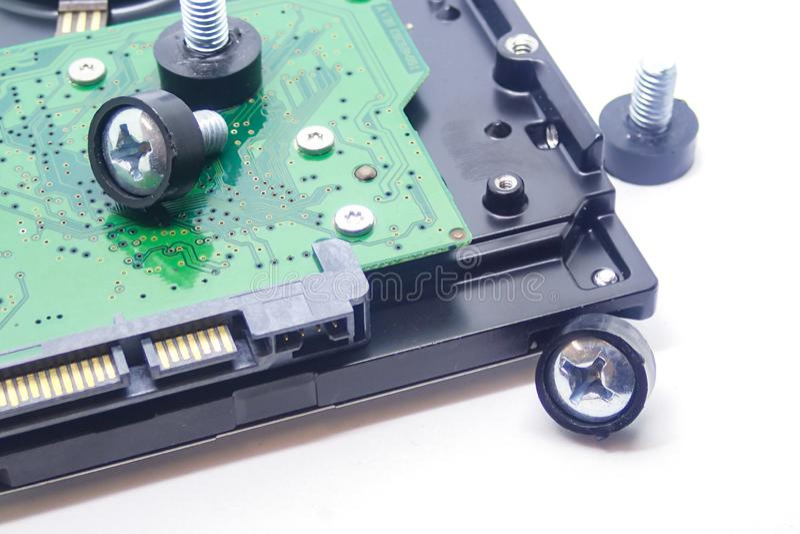 Hd жесткого диска микросхемы скрепляет болтами компьютерное оборудование ремонта дизайна предпосылки крупного плана хранения данн стоковые изображения