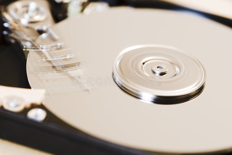 HD I. Hard disk head reading data stock image