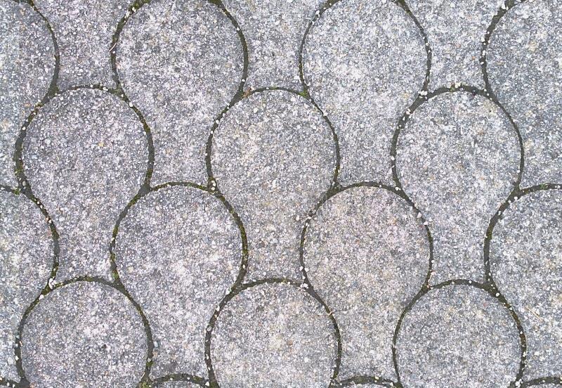 HD kształtujący kamiennego bruku bezszwowy tło zdjęcia stock