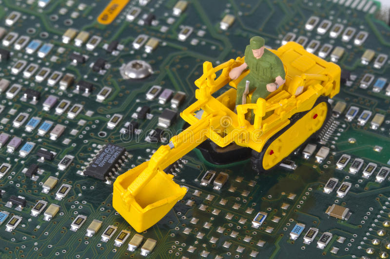 HDD with toy crawler mounted. Data security concept royalty free stock photos