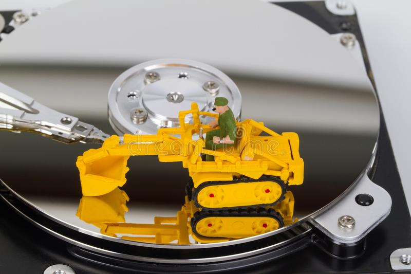 HDD with toy crawler mounted. Data security concept stock photos