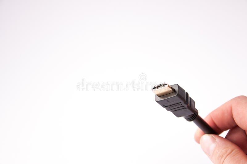 Hdmi кабеля с черной пропиткой соединиться в руке стоковое фото