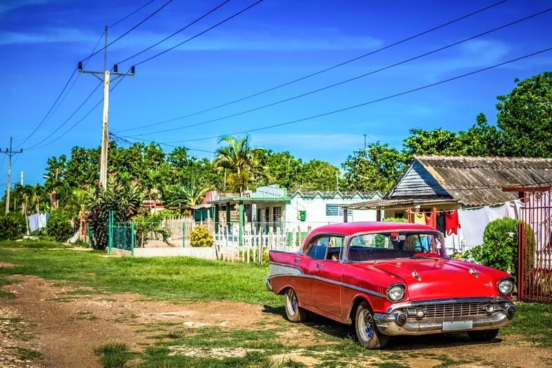 HDR - American red Dodge classic car parked on the side street in the province Matanzas in Cuba - Serie Cuba Reportage.  stock photo