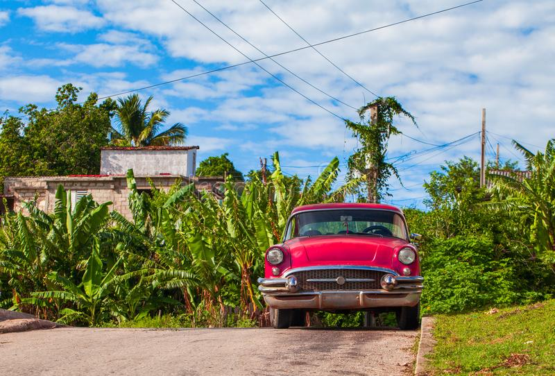 HDR - American red vintage car parked in the side street in Santa Clara Cuba - Serie Cuba Reportage.  stock image