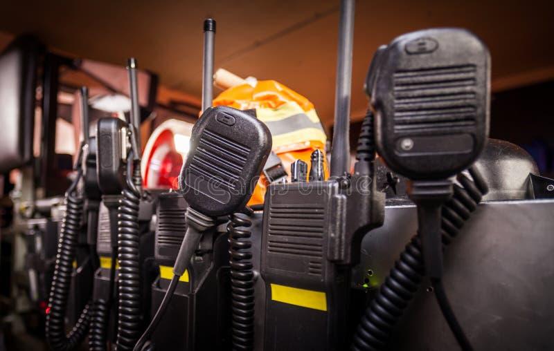 HDR - Attrezzatura del pompiere in un camion dei vigili del fuoco con i walkie-talkie fotografia stock libera da diritti