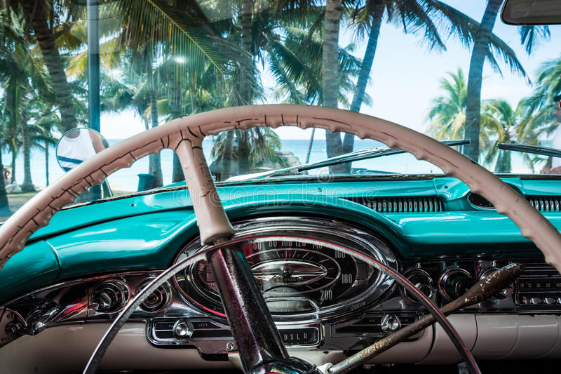 HDR Cuba interior view from a american classic car with view on the beach royalty free stock photos
