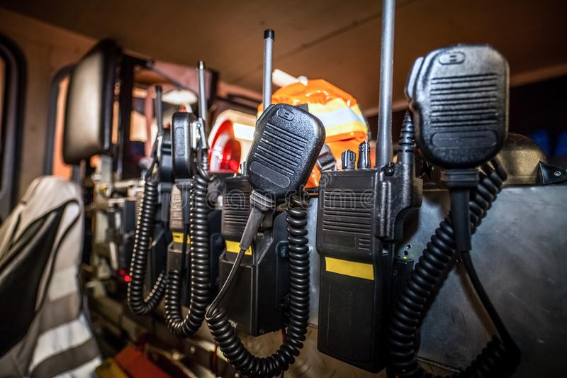 HDR - Firefighter equipment in a fire truck with walkie talkie. And halt stop trowel royalty free stock photo