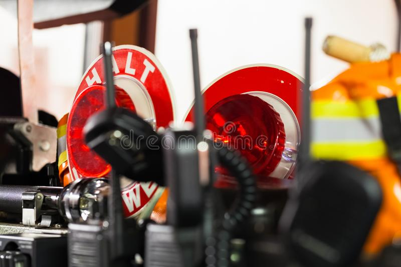 HDR - Firefighter equipment in a fire truck with walkie talkie. And halt stop trowel stock photo