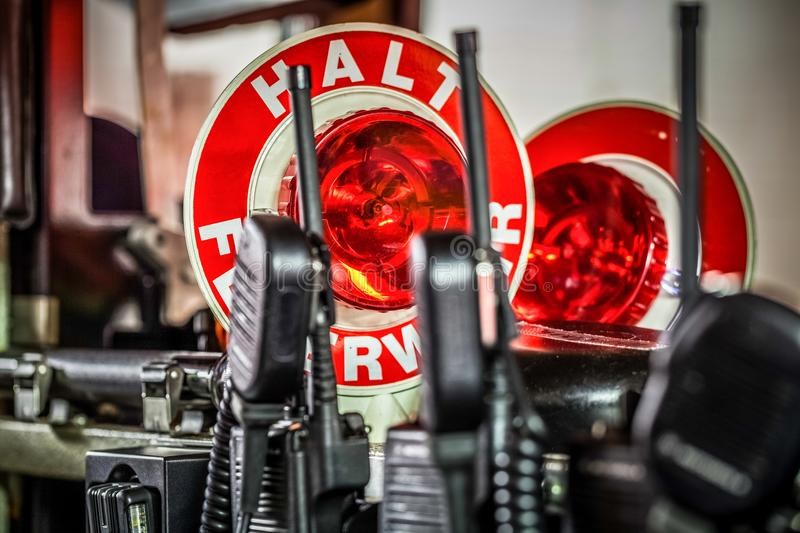 HDR - Firefighter equipment in a fire truck with walkie talkie. And halt stop trowel royalty free stock photography