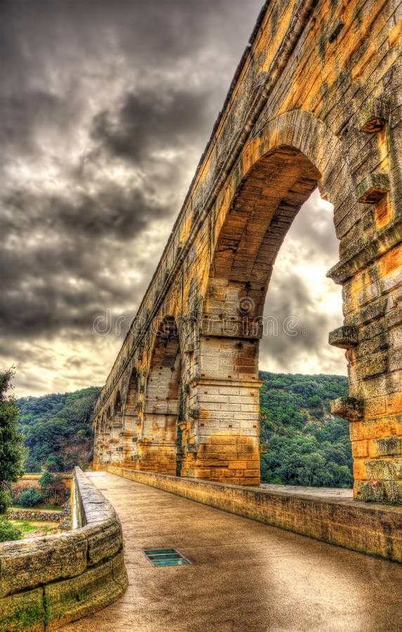 HDR image of Pont du Gard, ancient Roman aqueduct listed in UNESCO. France royalty free stock photo