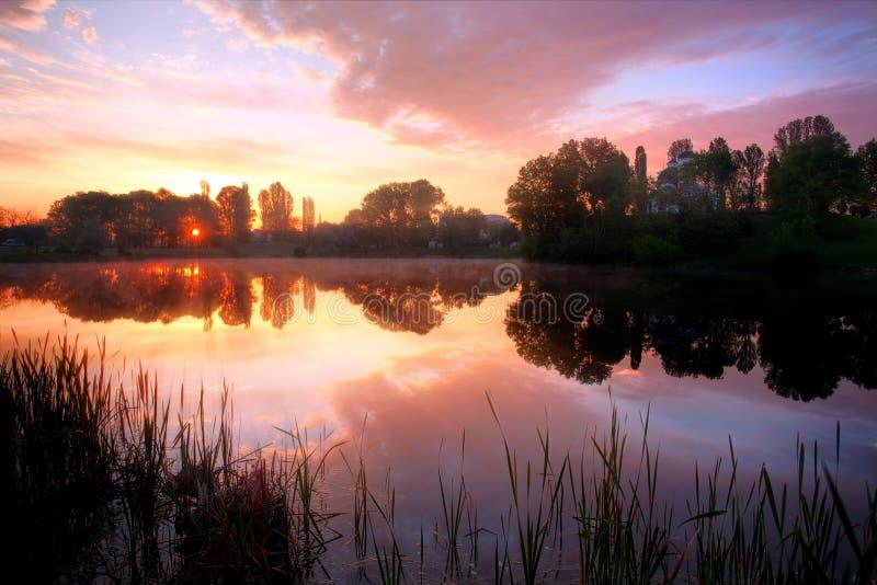 Hdr lake sunrise stock photo