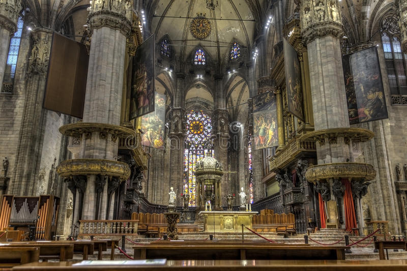 HDR photo Interior of the famous Cathedral Duomo di Milano on piazza in Milan. Interior of the famous Cathedral Duomo di Milano on piazza in Milan, Italy, shot royalty free stock images