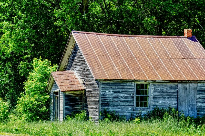 HDR photo of an old wood shack. In the woods royalty free stock photo
