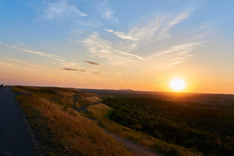Hdr picture of a sunset on a mountain. With clouds in the background royalty free stock images