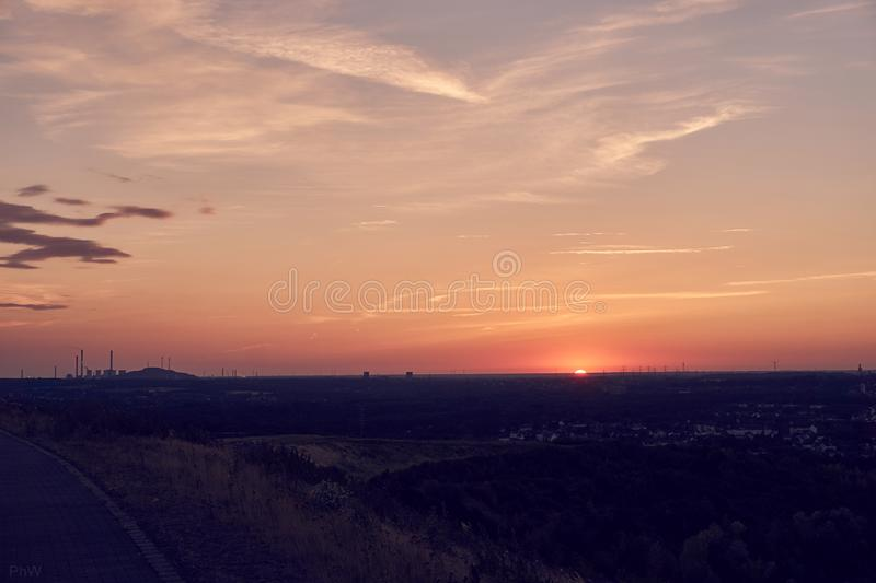 Hdr picture of a sunset on a mountain. With clouds in the background royalty free stock photos