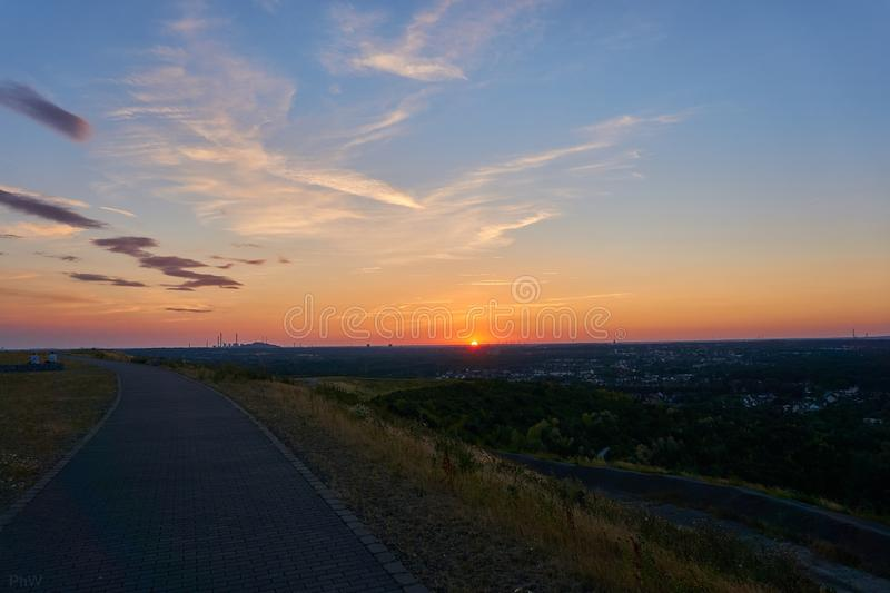 Hdr picture of a sunset on a mountain. With clouds in the background stock photos