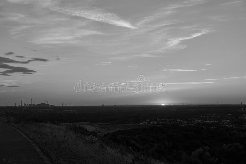 Hdr picture of a sunset on a mountain. With clouds in the background stock photo