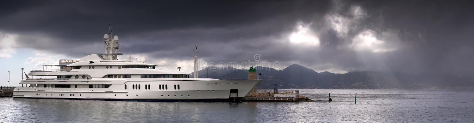 HDR Port Pierre Canto. A yacht boat in a safe harbor with a storm approaching in the sky royalty free stock photos