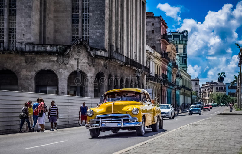 HDR - Street life scene in Havana Cuba with american vintage cars - Serie Cuba Reportage. HDR - Street life scene in Havana Cuba with american yellow vintage car stock photos