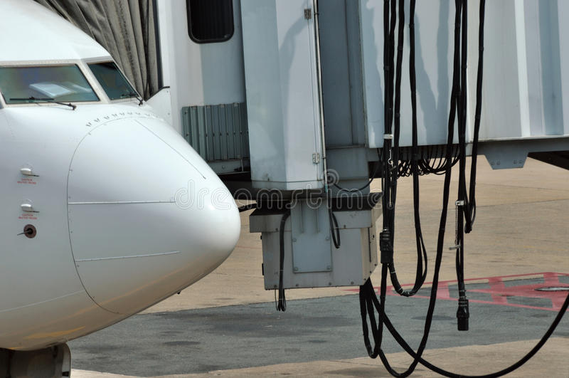 Download Head Of An Airplane And Airport Equipment Stock Photo - Image: 23564464