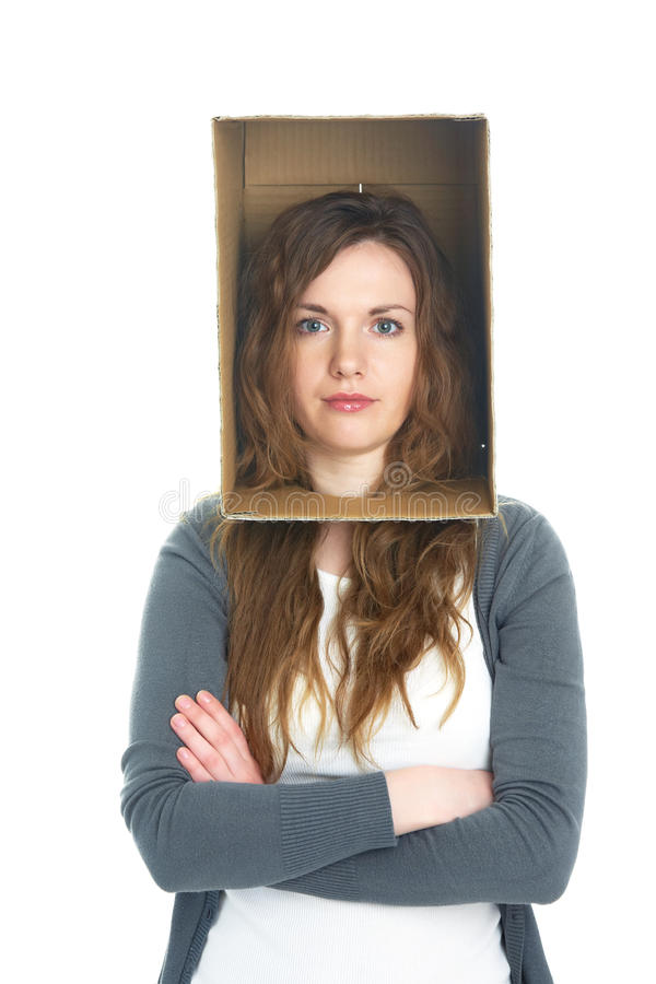 Head in box. Conceptual portrait of a woman's head hidden in a cardboard box royalty free stock images