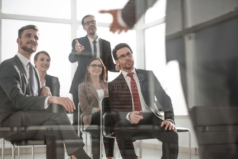 Head and business team at a business meeting to discuss stock photo