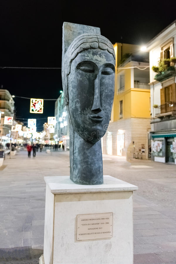 Head of Caryatid by A. Modigliani, Cosenza, Italy. COSENZA, ITALY - DECEMBER 28: Head of Caryatid, a sculpture by Amedeo Modigliani, is a public monument on the royalty free stock images