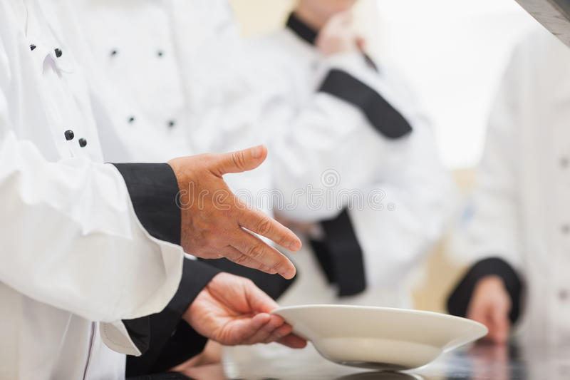 Download Head Chef Showing Class A Bowl Stock Photo - Image: 31009152