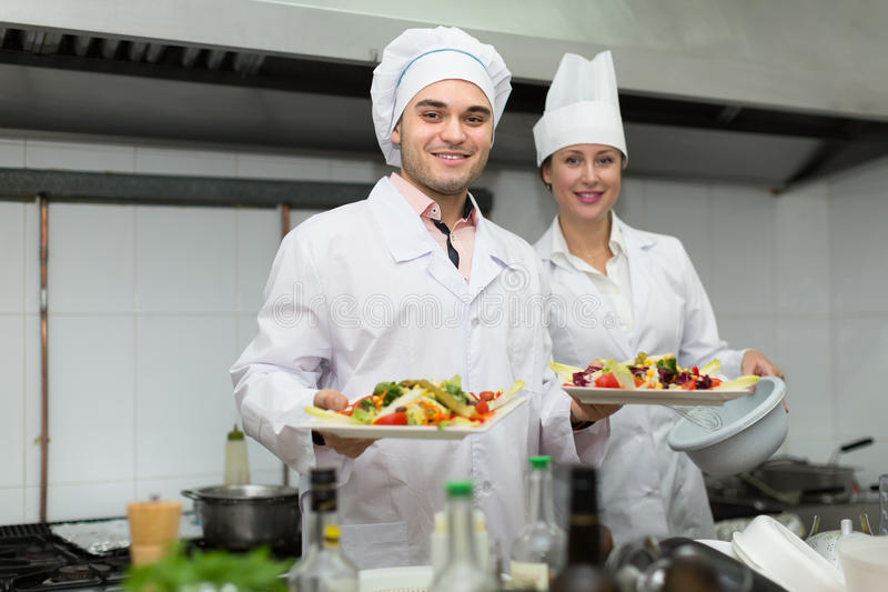 Exterior: Head-cooks Cooking At Professional Kitchen Stock Image