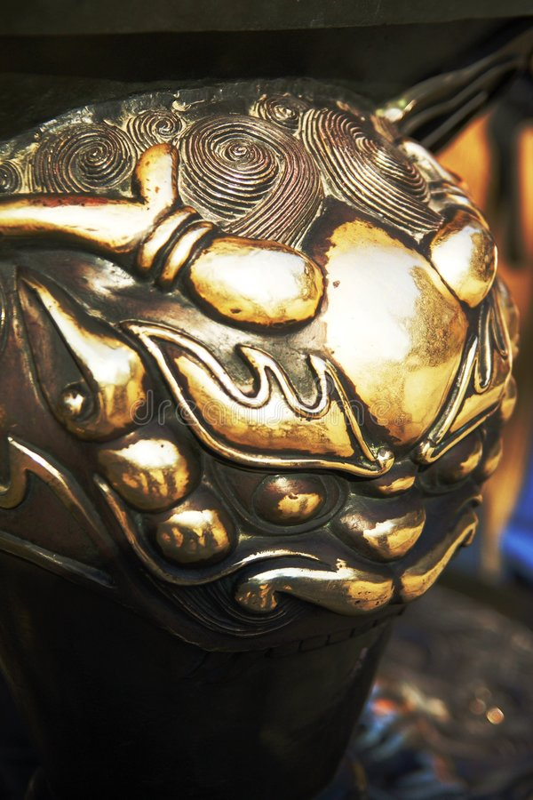 Head of cupreous lion. The Feature of the head of cupreous lion, which is the part of chinese censer stock images