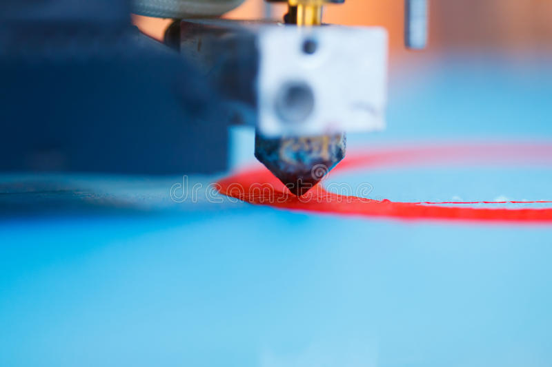 Head of 3d printer in action royalty free stock photo