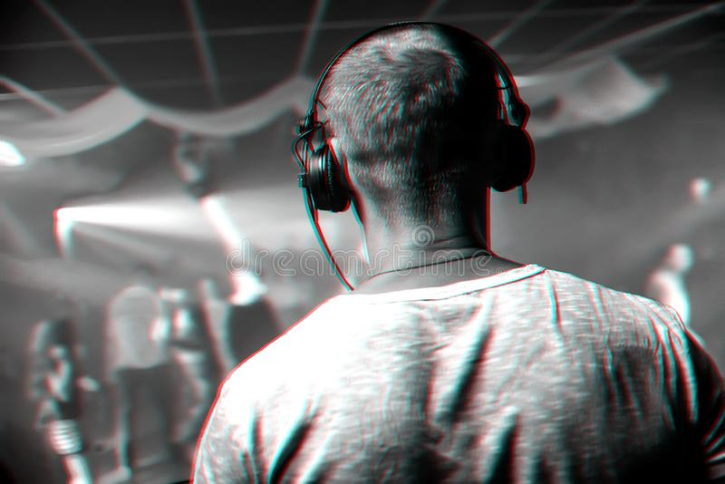 Head of DJ with headphones playing at event in nightclub. Head of a DJ with headphones playing at the event in a nightclub. Black and white photo with glitch royalty free stock photos