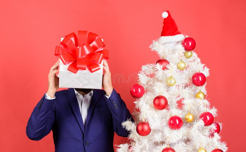 Head downtrodden with thoughts what to gift. Man bearded formal suit carry gift box on head. Christmas present idea. Concept. Thinking about gift ideas. Come up stock image