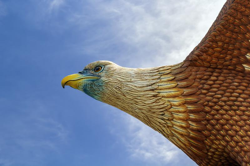 Head of an eagle statue on the central square of the island's stock photos