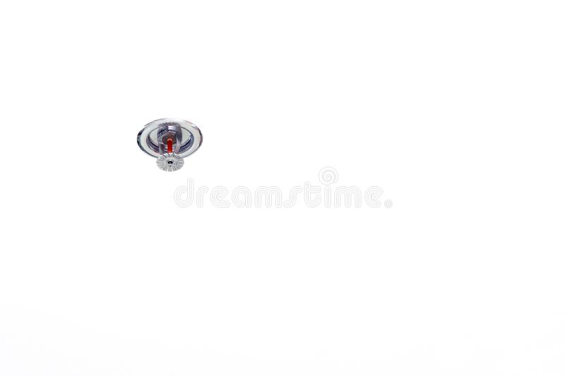 Head fire sprinkler in building When smoke, Automatic head fire sprinkler extinguisher on white background for safety alarm smoke. The Head fire sprinkler in royalty free stock image
