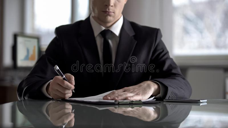 Head of firm signing agreement on restructuring of his company, raider seizure. Stock photo royalty free stock photography