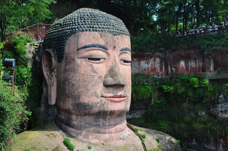 Head of the Giant Buddha statue in the rock royalty free stock image