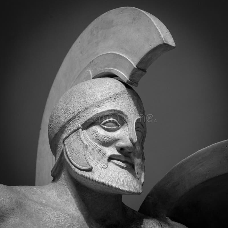 Head in helmet Greek ancient sculpture of warrior stock photo